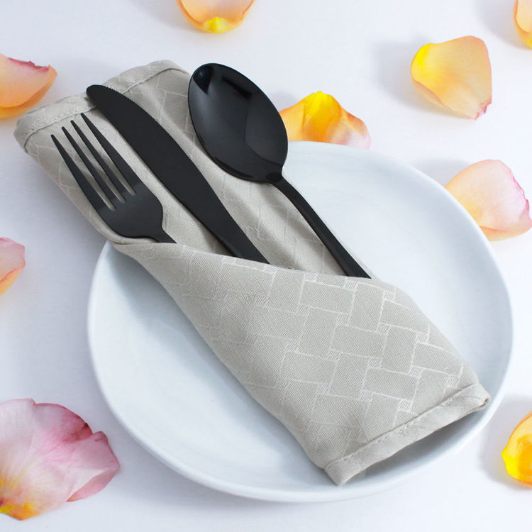 Reflective black flatware - cutlery - stainless steel - in napkin - rose petals